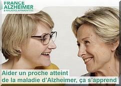 Presentación de la guía de France Alzheimer, con lema incluido.